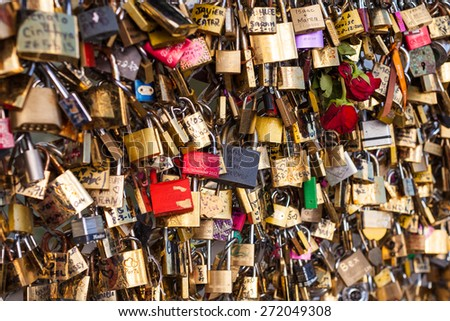 PARIS, FRANCE - MARCH 31, 2015: Lots of Padlocks On Bridge over the Seine, Paris France, symbolizing Love and Trust on March 31, 2015 in Paris, France - stock photo