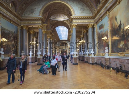 PARIS, FRANCE, MARCH 23, 2014: People are admiring collections of arts situated inside of the versailles palace in paris.