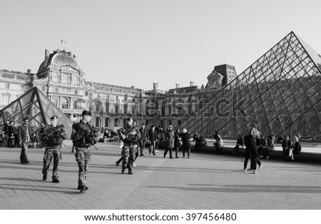 PARIS, FRANCE - MARCH 12, 2016: Soldiers patrolling near Louvre museum. France strengthened the measures to combat crime and terrorism.  - stock photo