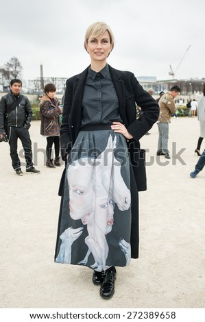PARIS, FRANCE - MARCH 10, 2015: Stylish European woman with painted skirt in the Tuileries Garden. Paris Fashion Week: Ready to Wear 2015/2016 is held from March 3 to 11, 2015. - stock photo