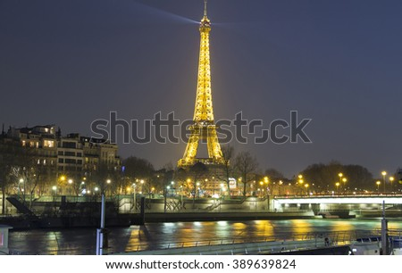 Paris; France-March 12; 2016 : The Eiffel tower is world known monument located on the bank of the Seine river in Paris, France. - stock photo