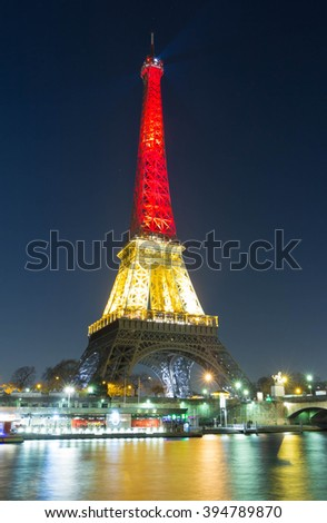 Paris; France-March 22, 2016 : The Eiffel tower lit up with the colors of National Belgian flag to honor to victims of today  terrorist's attack in Brussels. - stock photo