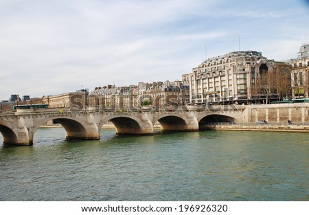 PARIS, FRANCE - MARCH 19, 2014: The historic Pont Neuf bridge crossing the River Seine. The oldest of the 35 bridges in Paris, construction was started in 1578.  - stock photo