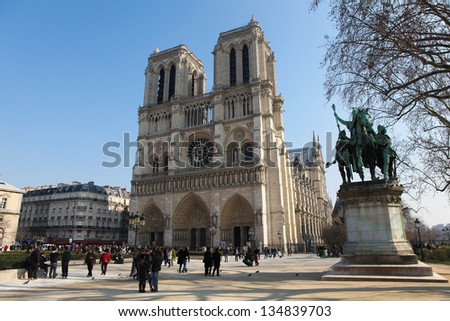 PARIS, FRANCE - March 4: Unidentified people in front of the Notre Dame cathedral of Paris, France, on March 4, 2011, one of the most famous landmarks of the French capital.
