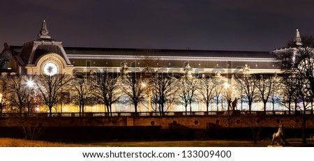 PARIS, FRANCE - MARCH 9: view of Musee d'Orsay at night. It is housed in the former Gare d Orsay, an impressive Beaux-Arts railway station built between 1898 and 1900, in Paris, France on March 2013 - stock photo