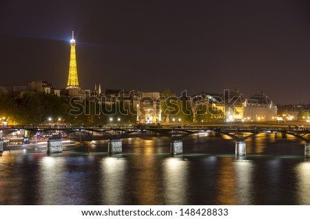 PARIS, FRANCE - MARCH 7: view of Pont des Arts in night in Paris, France on March 7, 2013. The present bridge was built between 1981 and 1984.