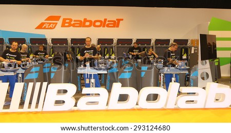 PARIS, FRANCE- MAY 29, 2015: Babolab tennis racquet stringing facility at Le Stade Roland Garros in Paris. Babolat is an Official Partner of the tournament and provides racquets, balls, strings - stock photo