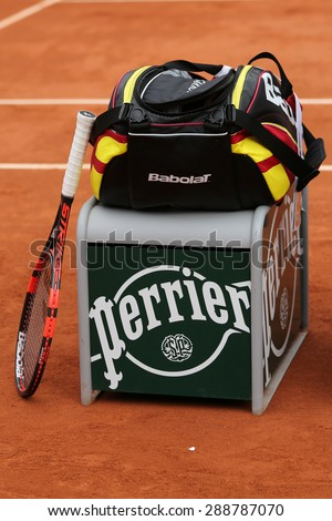 PARIS, FRANCE- MAY 29, 2015: Babolat Aero Pro racquet and tennis bag at Le Stade Roland Garros in Paris. Babolat is an Official Partner of the tournament and provides racquets, balls, strings - stock photo