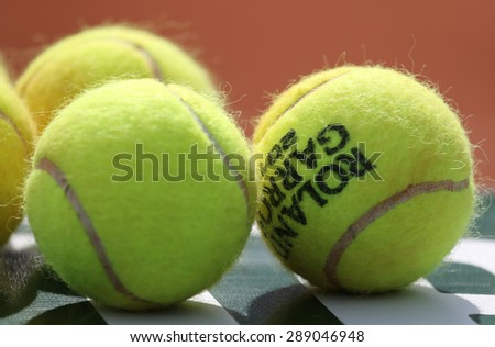 PARIS, FRANCE- MAY 29, 2015: Babolat Roland Garros 2015 tennis balls at Le Stade Roland Garros in Paris, France. Babolat is an Official Partner of the tournament and provides racquets, balls, strings - stock photo