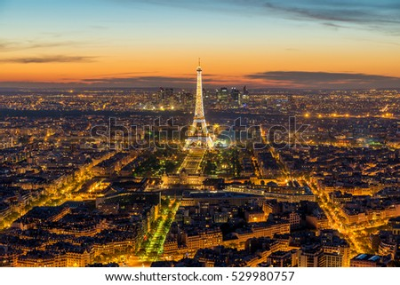 PARIS, FRANCE - May 5, 2016: Beautiful view Eiffel tower during light show at dusk, Paris, France
