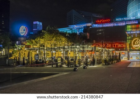 PARIS, FRANCE - MAY 9, 2014: Business district of Defense to the west of Paris at night. Defense is biggest business district in France and most of large companies have offices here.