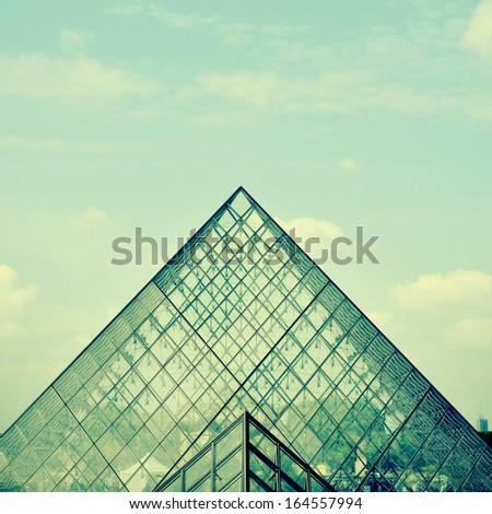 PARIS, FRANCE- MAY 17: Detail of the large glass pyramid of the Louvre Museum on May 17, 2013. The Louvre Museum is one of the largest museums of the world - stock photo