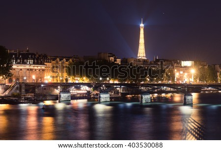 PARIS, FRANCE - MAY 22 2015: Eiffel Tower and Seine river at night in Paris. With the population of 2M, Paris is the capital and most-populous city of France. - stock photo