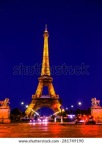 PARIS, FRANCE - May 5,2015: Eiffel Tower brightly illuminated at night on May 5, 2015 in Paris. The Eiffel tower is the most visited monument of France.  - stock photo