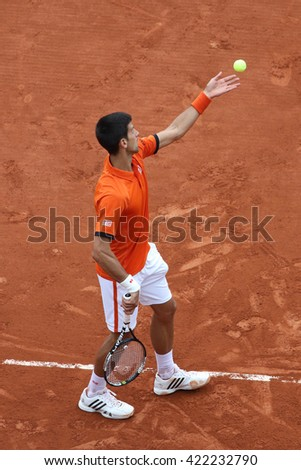 PARIS, FRANCE- MAY 28, 2015: Eight times Grand Slam champion Novak Djokovic in action during his second round match at Roland Garros 2015 in Paris, France - stock photo