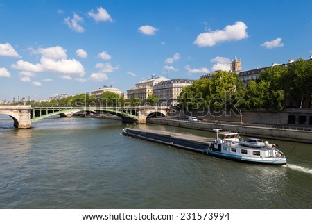 Paris, France - May 3, 2014: Embankment the River Seine opposite the Conciergerie. Sen, as one of the main transport highways of the town. - stock photo