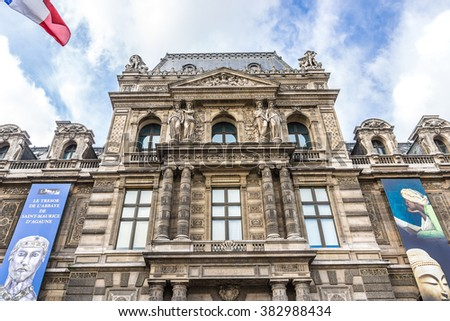 PARIS, FRANCE - MAY 8, 2014: Entrance to the Louvre Museum. Louvre Museum is one of the largest and most visited museums worldwide. - stock photo