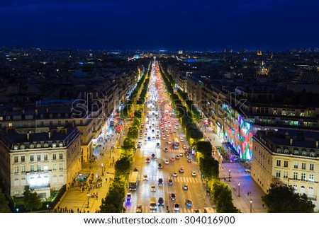 PARIS, FRANCE - MAY 29: Evening streetview of famous Champs Elysees with illumination and traffic seen from Arc de Triomphe on May 29, 2015 in Paris, France - stock photo