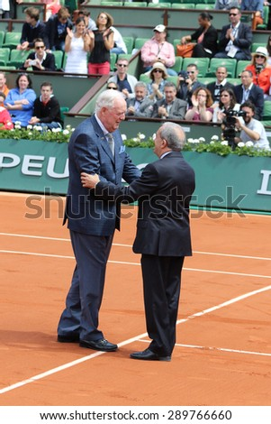 PARIS, FRANCE- MAY 30, 2015: Former tennis champion Fred Stolle, of Australia,  received a symbolic trophy, just 50 years after winning the French Open tennis tournament, at the Roland Garros stadium