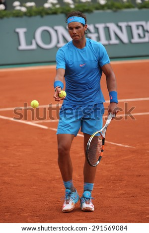 PARIS, FRANCE- MAY 28, 2015:Fourteen times Grand Slam champion Rafael Nadal in action during his second round match at Roland Garros 2015 in Paris, France - stock photo