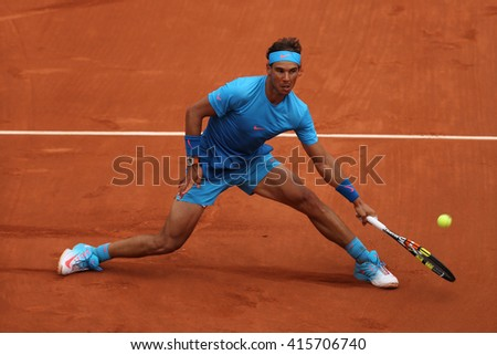 PARIS, FRANCE- MAY 26, 2015:Fourteen times Grand Slam champion Rafael Nadal in action during his match at Roland Garros 2015 in Paris, France - stock photo