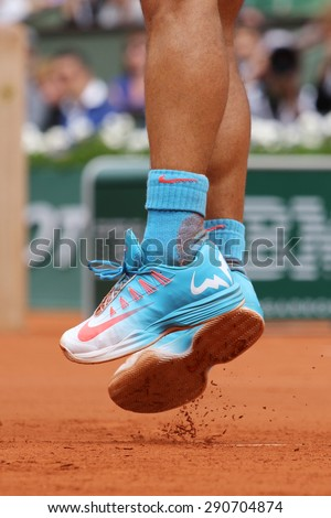 PARIS, FRANCE- MAY 28, 2015:Fourteen times Grand Slam champion Rafael Nadal wears custom Nike tennis shoes during second round match at Roland Garros 2015 in Paris, France - stock photo