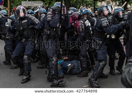 Paris, FRANCE - MAY 26, 2016 : French police, anti-riot squad, try to contain people during the massive protest over the labor law reforms.
