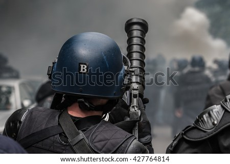 Paris, FRANCE - MAY 26, 2016 : French police, anti-riot squad, with gun of tear gas during the massive protest over the labor law reforms. - stock photo