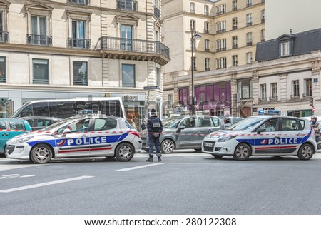 PARIS, FRANCE - MAY 21, 2015 : French police cars blocking a street in Paris - stock photo