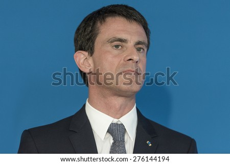 PARIS, FRANCE - MAY 7, 2015 : French Prime Minister Manuel Valls during the signing of the contract for the city 2015-2020 at the stadium Micheline Ostermeyer
