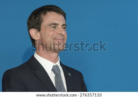 PARIS, FRANCE - MAY 7, 2015 : French Prime Minister Manuel Valls during the signing of the contract for the city 2015-2020 at the stadium Micheline Ostermeyer - stock photo