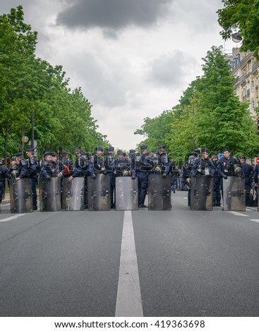 Paris, France - May 12, 2016 - French unions and students protest in Paris, France after the government forced through controversial labour reforms. A line of police line up to keep the peace. - stock photo