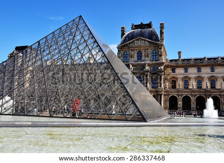 PARIS, FRANCE - MAY 7: Front view of the Louvre museum in Paris on May 7, 2011. Louvre is one of the world's largest museums located in Paris, France. - stock photo