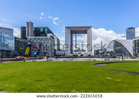 """PARIS, FRANCE - MAY 13, 2014: Grand Arch (""""Grande Arche de la Defense"""", 1989) - a monument in business district of Defense to west of Paris. Arch is a monument to humanity and humanitarian ideals. - stock photo"""