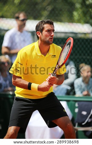 PARIS, FRANCE- MAY 30, 2015: Grand Slam Champion Marin Cilic of Croatia in action during his third round match at Roland Garros 2015 in Paris, France - stock photo