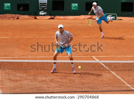 PARIS, FRANCE- MAY 29, 2015: Grand Slam champions Mike and Bob Bryan of United States in action during second round match at Roland Garros 2015 in Paris, France - stock photo