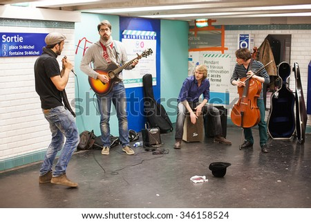 Paris, France-May 16, 2013. Group of musicians busking in a Paris Metro train station - stock photo