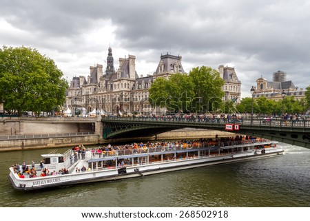 Paris, France - May 7, 2014: Hotel-de-Ville (City Hall) in Paris - an office building in the center of Paris. Bridge over the River Seine on Cite island.