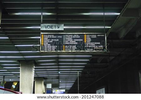 PARIS, FRANCE - MAY 9, 2014: Interior of La Defense RER (metropolitan underground transportation of Paris) station. It is located underneath Grande Arche building in Paris La Defense business district - stock photo