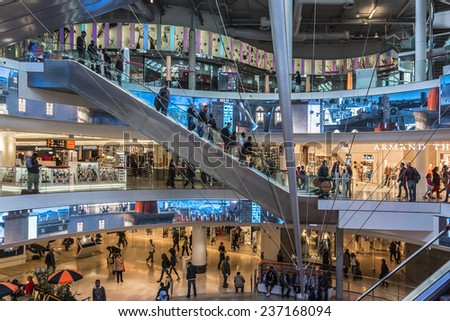 "PARIS, FRANCE - MAY 14, 2014: Interior of shopping mall ""Four Seasons"" near Arche de la Defense, Paris. It has many retail shops as well as cafes and restaurants. - stock photo"
