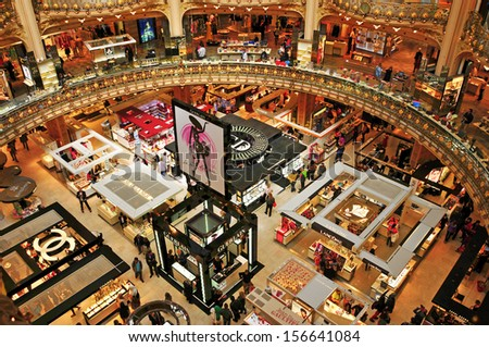 PARIS, FRANCE-MAY 18: Interior of the emblematic building of the Galeries Lafayette on May 18, 2013. In 2012, the dome of Lafayette premises in the Boulevard Haussmann celebrated its 100th anniversary - stock photo