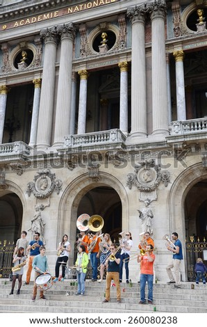 Paris,France - 28 May, 2014 : Les Plaies Mobiles, Young brass band show on Paris Opera building. Dozens buskers perform on the streets and in metro in Paris, France. - stock photo