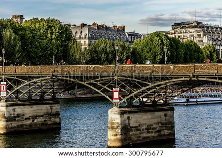 PARIS, FRANCE - MAY 30, 2015: Lockers at Pont des Arts (Passerelle des Art) symbolize love for ever. From 2008 to June 1, 2015, over a million locks were placed, weighing approximately 45 tons.