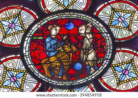 PARIS, FRANCE - MAY 31, 2015  Lost Sheep Parable Jesus Christ Stained Glass Notre Dame Cathedral Paris France.  Notre Dame was built between 1163 and 1250 AD. - stock photo