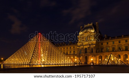 PARIS, FRANCE - MAY 9,2014: Louvre Museum (Musee du Louvre) and the Pyramid in Paris, France, at night illumination. Louvre is the most famous and visited Museum in Paris.