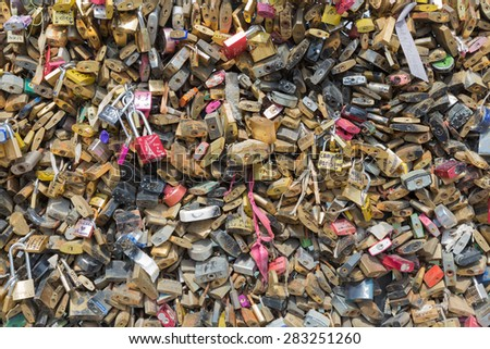 PARIS, FRANCE - MAY 28: Love padlocks representing eternal love of couples who lock padlocks at bridges over the Seine river on May 28, 2015 in Paris, France - stock photo