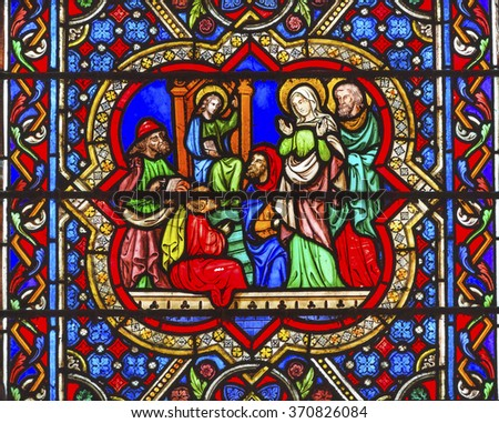 PARIS, FRANCE -  MAY 31, 2015 Mary Jesus Christ Joseph Worshipers Stained Glass Notre Dame Cathedral Paris France.  Notre Dame was built between 1163 and 1250 AD.   - stock photo