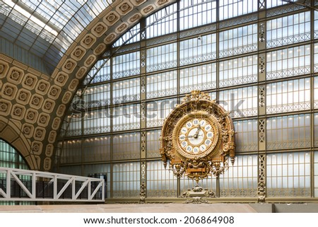 PARIS, FRANCE - MAY 17, 2014: Musee d'Orsay Clock by Victor Laloux. Opened in 1986, the museum houses the largest collection of impressionist and post-impressionist masterpieces in the world. - stock photo