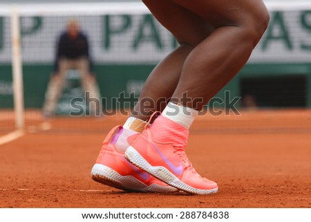 PARIS, FRANCE- MAY 28, 2015: Nineteen times Grand Slam champion Serena Willams wears custom Nike tennis shoes during second round match at Roland Garros 2015 in Paris, France - stock photo