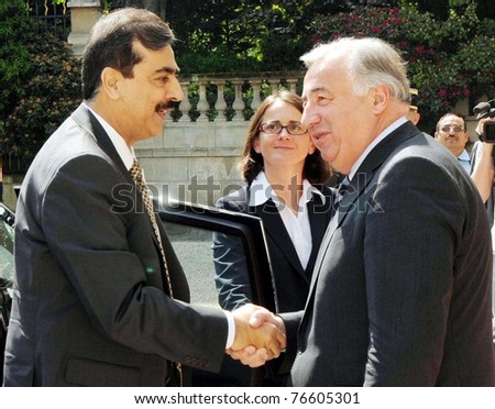 PARIS, FRANCE - MAY 03: Pakistan Prime Minister, Syed Yousuf Raza Gilani, being received by Gerard Larcher President of the French Senate, during his visits on May 04, 2011 in Paris.